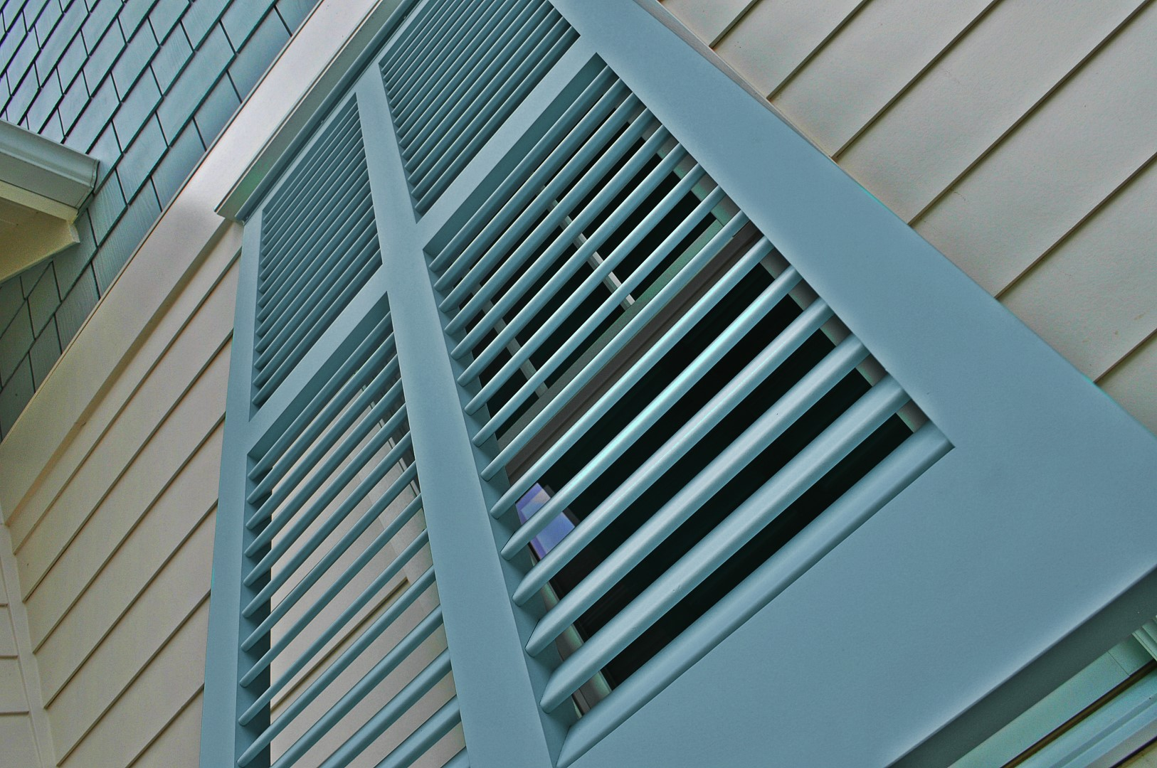 Window treatment idea - Bermuda or Bahama shutter for exterior.