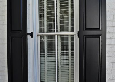 Outdoor shutters of Harmony Raised Panel Shutters in perspective.