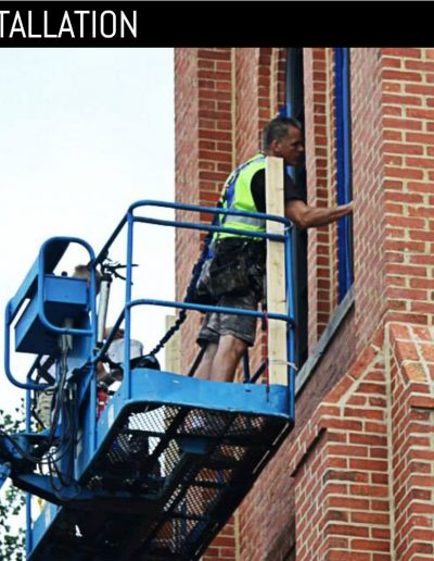 Work installing louvered shutter at historic church using lift.