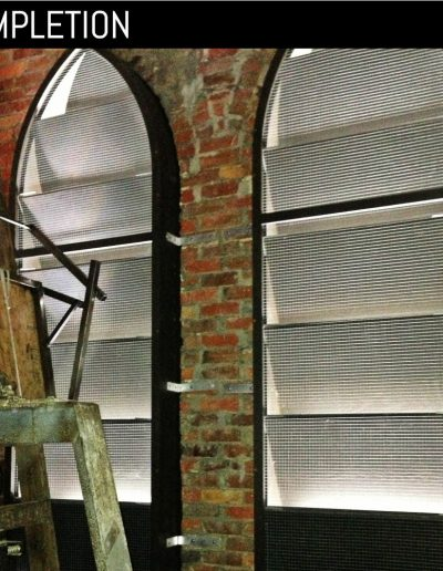 Inside view of new, custom, louvered shutter at church in Goldsboro, NC.